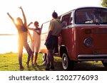friends dancing in the light of ... | Shutterstock . vector #1202776093