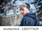 portrait of young man in hoodie ... | Shutterstock . vector #1202777629