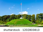a tall flagpole on top of the... | Shutterstock . vector #1202803813