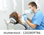 happy dentist working making a... | Shutterstock . vector #1202809786