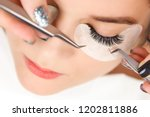 eyelash extension procedure.... | Shutterstock . vector #1202811886