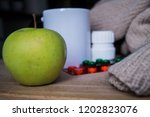 apple saver with drugs | Shutterstock . vector #1202823076