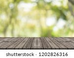 empty wood table top on nature... | Shutterstock . vector #1202826316