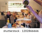 close up of champagne tower... | Shutterstock . vector #1202866666