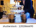 man in suit fills the 4 tier... | Shutterstock . vector #1202866690