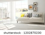 white modern room with sofa.... | Shutterstock . vector #1202870230