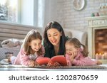 winter portrait of happy loving ... | Shutterstock . vector #1202870659