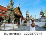 woman tourist is enjoy... | Shutterstock . vector #1202877349