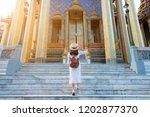 woman tourist is enjoy... | Shutterstock . vector #1202877370