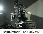 cinema projector with a film on ... | Shutterstock . vector #1202887549