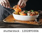 male hands holding cooked... | Shutterstock . vector #1202893306