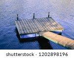 floating docks and river... | Shutterstock . vector #1202898196