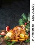 roasted christmas chicken or... | Shutterstock . vector #1202903299