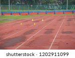 artificial track and field with ... | Shutterstock . vector #1202911099