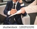 close up of man hand holding... | Shutterstock . vector #1202913190