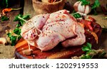 raw whole chicken with spices... | Shutterstock . vector #1202919553