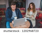 couple sitting in cafe. man... | Shutterstock . vector #1202968723