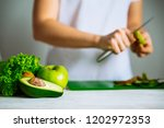 green fruits on front. woman... | Shutterstock . vector #1202972353