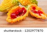 ripe fruits of momordica... | Shutterstock . vector #1202977870