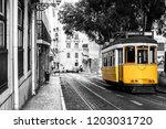 yellow tram on old streets of... | Shutterstock . vector #1203031720