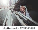 arabic businessman looking at... | Shutterstock . vector #1203043420