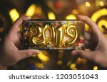 taking picture with smartphone. ... | Shutterstock . vector #1203051043