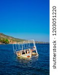 semi sunken boat on the shore...   Shutterstock . vector #1203051220