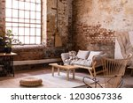 pouf and wooden table on carpet ... | Shutterstock . vector #1203067336