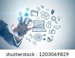hand of unrecognizable... | Shutterstock . vector #1203069829