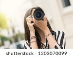 woman portrait taking a picture ... | Shutterstock . vector #1203070099
