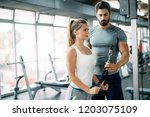 personal trainer assisting... | Shutterstock . vector #1203075109
