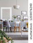 lamp above chairs and table in... | Shutterstock . vector #1203076240