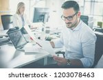 making sure everything is in... | Shutterstock . vector #1203078463