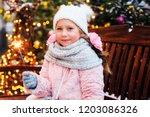 christmas portrait of happy... | Shutterstock . vector #1203086326