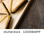 cheesecake  brownie on the wood ... | Shutterstock . vector #1203086899