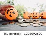 hand hold pumpkin bucket ... | Shutterstock . vector #1203092620