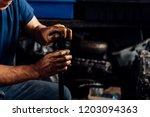 car mechanic or serviceman... | Shutterstock . vector #1203094363