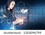 businesswoman with planner in... | Shutterstock . vector #1203096799