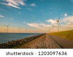 offshore windmill farm in the... | Shutterstock . vector #1203097636