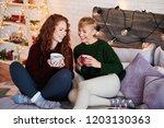 friends drinking tea and... | Shutterstock . vector #1203130363