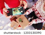 woman's hands photographing... | Shutterstock . vector #1203130390