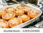delicious baked tomatoes with... | Shutterstock . vector #1203132400