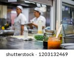 kitchen staff busy with... | Shutterstock . vector #1203132469