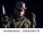 military man with a sharp steel ... | Shutterstock . vector #1203146176