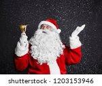 santa claus with handbell among ... | Shutterstock . vector #1203153946