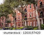 a row of red brick 3 story...   Shutterstock . vector #1203157420