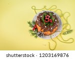 christmas cake on yellow... | Shutterstock . vector #1203169876