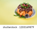 christmas cake on yellow... | Shutterstock . vector #1203169879