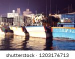 the fishing boat docked in the...   Shutterstock . vector #1203176713