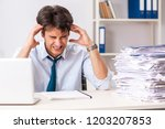 overloaded busy employee with...   Shutterstock . vector #1203207853